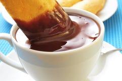 Melindros de Xocolata i, chocolat chaud avec les pâtisseries typiques du chat Photographie stock
