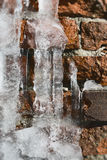 Meling Ice on old Brick Wall Royalty Free Stock Images