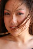 Melissa 2. Head shot of young asian woman with piercing in nose and lip Royalty Free Stock Photo