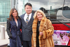 Melissa Rivers, David W. Chien, and Joan Rivers. Melissa and Joan Rivers celebrate their  induction into the Gray Line New York Ride of Fame campaign.  The event Royalty Free Stock Image
