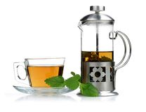 Melissa tea in a glass cup with lemon balm and teapot stock photo