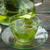 Melissa tea. Herbal tea with melissa in a glass cup and teapot Royalty Free Stock Photo