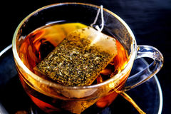 Melissa tea. With teabag on a black background royalty free stock images