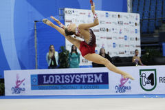 Melitina Staniouta with clubs. PESARO, ITALY - APRIL 28: Melitina Staniouta from Belarus performs with clubs during the rhythmic gymnastic World Cup on April 28 stock photo