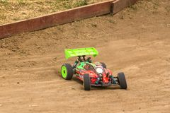 2016/06/18 Melitopol. Ukraine. Competitions between buggy models. Radio controlled car model in race on dirt track Stock Photos