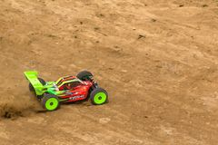 2016/06/18 Melitopol. Ukraine. Competitions between buggy models. Radio controlled car model in race on dirt track Royalty Free Stock Photos