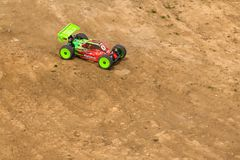 2016/06/18 Melitopol. Ukraine. Competitions between buggy models. Radio controlled car model in race on dirt track Stock Images