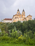 Melk Abbey. Imposing facade of the Abbey of Melk, located in Austria, over the trees of a forest next to the Danube river Royalty Free Stock Image