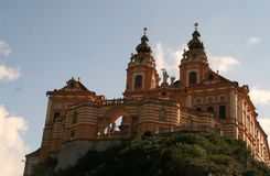 Melk Abbey. Austria`s Melk Abbey sits high on hill, displaying its beautiful and colorful Baroque style built for the Benedictine Monks in 1089 Stock Photography