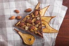 Melkchocola met peer en amandelen Royalty-vrije Stock Foto