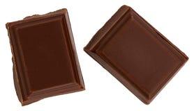Melkchocolastukken op witte achtergrond van hoogste mening worden geïsoleerd die royalty-vrije stock afbeeldingen