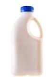 Melkfles die op Witte Achtergrond wordt geïsoleerd Stock Afbeeldingen