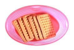 Melkkoekjes in een roze snack plastic doos met GLB royalty-vrije stock fotografie