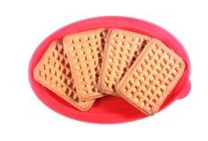 Melkkoekjes in een roze snack plastic doos met GLB royalty-vrije stock foto's