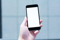 Mellanrumet och den vita skärmen av den smarta telefonen Fotografering för Bildbyråer