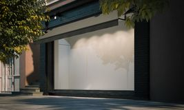 Mellanrumet shoppar fönstret i nattgatan med ljus på ramen framförande 3d Arkivfoto