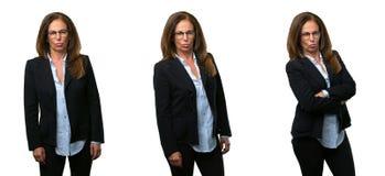 Mellersta ålderaffärskvinna med långt hår arkivfoton