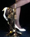 Mellophone and Legs Black Backgroune. A mellophone and legs against as black backgroung in the vertical or portrait view Royalty Free Stock Image