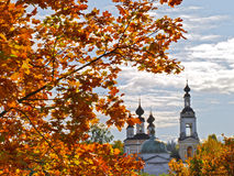 Mellow autumn in Pless. Mellow autumn in ancient small town (Pless town). Orthodox church on the second plan Stock Image