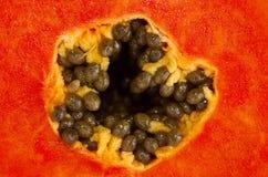 Mellow Papaya. Slice of bright orange sweet mellow papaya isolated on white Royalty Free Stock Images
