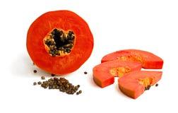 Mellow Papaya. Slice of bright orange sweet mellow papaya isolated on white Stock Image