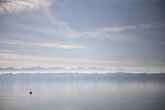 Mellow vibe on Lake. Soft colored sky at a lake Royalty Free Stock Photography