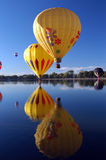 Mellow Yellow. Hot Air Balloon over lake with a reflection royalty free stock photo