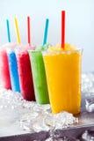 Melma congelata Granitas della frutta in tazze di plastica Fotografia Stock Libera da Diritti