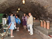 MELNIK, CZECH REPUBLIC. An excursion in the wine vault of the Melnitsky lock. MELNIK, CZECH REPUBLIC - MAY 26, 2014: An excursion in the wine vault of the royalty free stock image