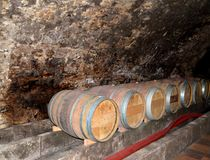 MELNIK, CZECH REPUBLIC. Wine casks in the cellar of the museum of winemaking. MELNIK, CZECH REPUBLIC - MAY 26, 2014: Wine casks in the cellar of the museum of royalty free stock image