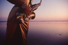 Melodia dell'acqua del sassofono Fotografie Stock Libere da Diritti