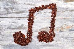 Melodia kształt od kawowych fasoli obraz stock