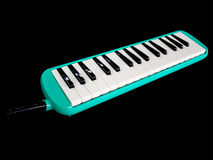 A Melodion  in black background. Closeup shot of Melodion  in black background Royalty Free Stock Photography