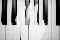 Melody. Concept photo. Double exposure. Black and white. Hand and piano. Melody. Concept photography stock photography