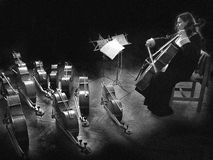 Melody. Musician before concert playing the cello melody Royalty Free Stock Photo