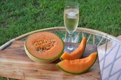 Meloen en champagne Stock Fotografie