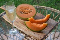 Meloen en champagne Stock Afbeelding