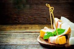 Meloen en ham Stock Afbeelding