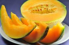 Meloen en plakken op blauwe achtergrond Royalty-vrije Stock Afbeelding