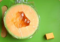 Meloen onder Plastic Omslag Stock Fotografie