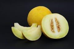 Meloen op een zwarte achtergrond Royalty-vrije Stock Afbeeldingen