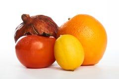 Melograno arancio del cachi del limone maturo di frutti Immagini Stock