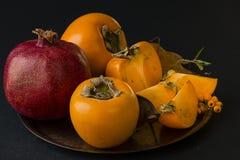 Melograno e frutta delle fette del cachi Fotografia Stock Libera da Diritti