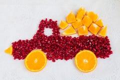 Melograno ed arancia come forma del camion Immagini Stock