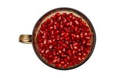 Melograno rosso in una ciotola Fotografia Stock