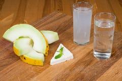 Melonów plasterki, feta mennica z rak i ser i Obrazy Stock
