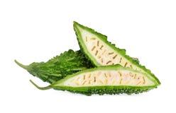 Melon amer avec la demi tranche d'isolement sur le blanc Images stock