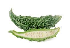 Melon amer d'isolement sur un fond blanc Images stock
