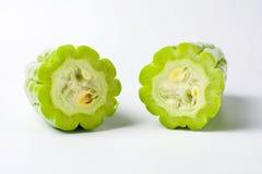 Melon amer sur le fond blanc Photographie stock libre de droits