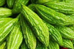 Melon amer sur le marché asiatique Photos stock